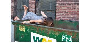 Man Digging in Dumpster