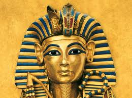The gold mask of King Tutankhamun is seen alongside a dagger found in the  wrapping of